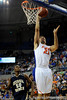 photo by Casey Brooke Lawson<br /> <br /> Florida junior forward Dan Werner scores over Georgia Southern guard Willie Powers in the second half. The Gators beat the Eagles 88 to 81 at the O'Connell Center in Gainesville, Fla. on December 22, 2008.