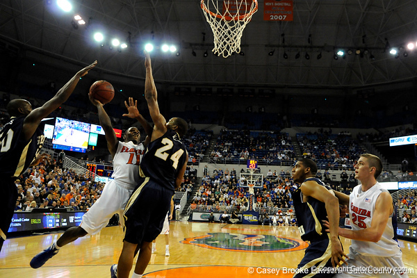 photo by Casey Brooke Lawson<br /> <br /> Florida freshman guard Erving Walker scores over Georgia Southern guard Julian Allen. The Gators beat the Eagles 88 to 81 at the O'Connell Center in Gainesville, Fla. on December 22, 2008