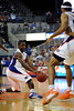 photo by Casey Brooke Lawson<br /> <br /> Florida freshman guard Erving Walker passes the ball to forward Alex Tyus during the second half. The Gators beat the Eagles 88 to 81 at the O'Connell Center in Gainesville, Fla. on December 22, 2008.