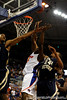 photo by Casey Brooke Lawson<br /> <br /> Florida freshman guard/forward Ray Shipman scores over Georgia Southern forward Tyler Troupe and guard Julian Allen. The Gators beat the Eagles 88 to 81 at the O'Connell Center in Gainesville, Fla. on December 22, 2008