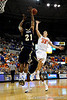 photo by Casey Brooke Lawson<br /> <br /> Florida sophomore guard/forward Nick Calathes scores over Georgia Souther forward Tyler Troupe in the first half. The Gators beat the Eagles 88 to 81 at the O'Connell Center in Gainesville, Fla. on December 22, 2008