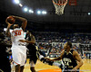 photo by Casey Brooke Lawson<br /> <br /> Florida freshman forward/center Kenny Kadji scores over Georgia Southern guard Julian Allen. The Gators beat the Eagles 88 to 81 at the O'Connell Center in Gainesville, Fla. on December 22, 2008