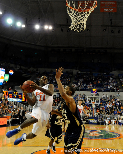 photo by Casey Brooke Lawson<br /> <br /> Florida freshman guard Erving Walker scores over Georgia Southern forward Sandy Perry. The Gators beat the Eagles 88 to 81 at the O'Connell Center in Gainesville, Fla. on December 22, 2008.