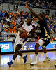 photo by Casey Brooke Lawson<br /> <br /> Florida freshman guard Erving Walker moves the ball past a Georgia Southern player in the first half. The Gators beat the Eagles 88 to 81 at the O'Connell Center in Gainesville, Fla. on December 22, 2008