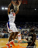 photo by Casey Brooke Lawson<br /> <br /> Florida sophomore forward Alex Tyus scores over Georgia Southern guard Willie Powers. The Gators beat the Eagles 88 to 81 at the O'Connell Center in Gainesville, Fla. on December 22, 2008.
