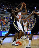 photo by Casey Brooke Lawson<br /> <br /> Florida freshman forward/center Kenny Kadji moves the ball past a Georgia Southern player in the first half. The Gators beat the Eagles 88 to 81 at the O'Connell Center in Gainesville, Fla. on December 22, 2008