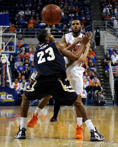 photo by Casey Brooke Lawson<br /> <br /> Florida senior guard Walter Hodge passes the ball to a teammate in the first half. The Gators beat the Eagles 88 to 81 at the O'Connell Center in Gainesville, Fla. on December 22, 2008