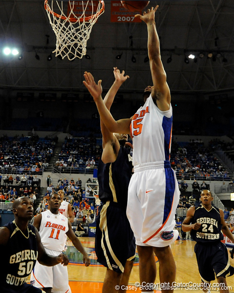 photo by Casey Brooke Lawson<br /> <br /> Florida senior guard Walter Hodge scores over a Georgia Southern player. The Gators beat the Eagles 88 to 81 at the O'Connell Center in Gainesville, Fla. on December 22, 2008.