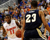 photo by Casey Brooke Lawson<br /> <br /> Florida freshman guard Erving Walker moves the ball past Georgia Southern forward Sandy Perry in the second half. The Gators beat the Eagles 88 to 81 at the O'Connell Center in Gainesville, Fla. on December 22, 2008.