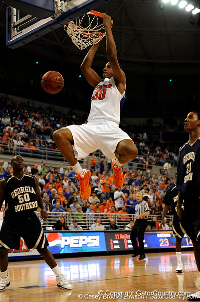 photo by Casey Brooke Lawson<br /> <br /> Florida freshman forward/center Kenny Kadji scores over two Georgia Southern players in the first half. The Gators beat the Eagles 88 to 81 at the O'Connell Center in Gainesville, Fla. on December 22, 2008