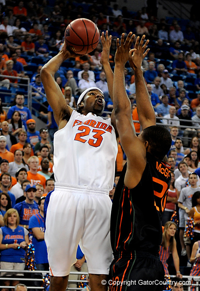 UF forward Alex Tyus moves the ball around a Miami player during the first half of the Florida Gators' game against the Miami Hurricanes on Friday, March 20, 2009 in Gainesville, Fla. / Gator Country photo by Casey Brooke Lawson