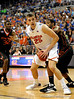 UF forward Chandler Parsons moves the ball past two Miami players during the second half of the Florida Gators' game against the Miami Hurricanes on Friday, March 20, 2009 in Gainesville, Fla. / Gator Country photo by Casey Brooke Lawson