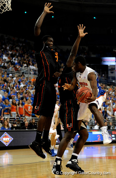 UF guard Erving Walker moves the ball around a Miami player during the first half of the Florida Gators' game against the Miami Hurricanes on Friday, March 20, 2009 in Gainesville, Fla. / Gator Country photo by Casey Brooke Lawson