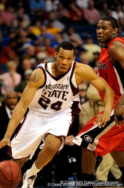 Mississippi State forward Kodi Augustus moves the ball past a Georgia player during the Mississippi Bulldogs 79-60 victory over the University of Georgia Bulldogs on Thursday, March 12, 2009 in the St. Pete Times Forum. / Gator Country photo by Casey Brooke Lawson