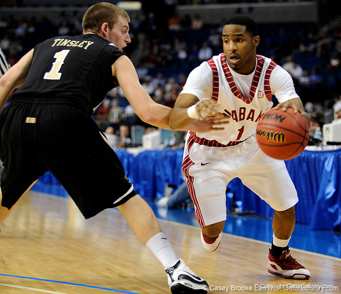 Alabama guard Anthony Brock moves the ball past a Vanderbilt player during the Alabama Crimson Tide 82-75 victory over the Vanderbilt Commodores on Thursday, March 12, 2009 in the St. Pete Times Forum. / Gator Country photo by Casey Brooke Lawson