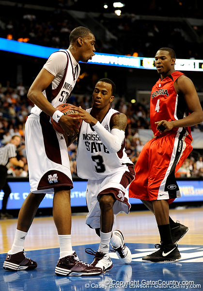 Mississippi State guard Dee Bost moves the ball past a Georgia player during the Mississippi Bulldogs 79-60 victory over the University of Georgia Bulldogs on Thursday, March 12, 2009 in the St. Pete Times Forum. / Gator Country photo by Casey Brooke Lawson