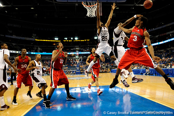 Mississippi forward Jarvis Varnado knocks the ball from Georgia guard Dustin Ware during the Mississippi Bulldogs 79-60 victory over the University of Georgia Bulldogs on Thursday, March 12, 2009 in the St. Pete Times Forum. / Gator Country photo by Casey Brooke Lawson