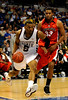 MIssissippi State forward Romero Osby moves the ball past Georgia forward Trey Thompkins during the Mississippi Bulldogs 79-60 victory over the University of Georgia Bulldogs on Thursday, March 12, 2009 in the St. Pete Times Forum. / Gator Country photo by Casey Brooke Lawson