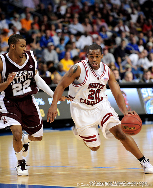 South Carolina guard Zam Fredrick moves the ball past a Mississippi State player during the first half of the Mississippi State Bulldogs game against the South Carolina Gamecocks on Friday, March 13, 2009 in the St. Pete Times Forum. / Gator Country photo by Casey Brooke Lawson