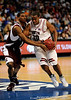 South Carolina guard Zam Fredrick attempts to move the ball past a Mississippi State player during the first half of the Mississippi State Bulldogs game against the South Carolina Gamecocks on Friday, March 13, 2009 in the St. Pete Times Forum. / Gator Country photo by Casey Brooke Lawson