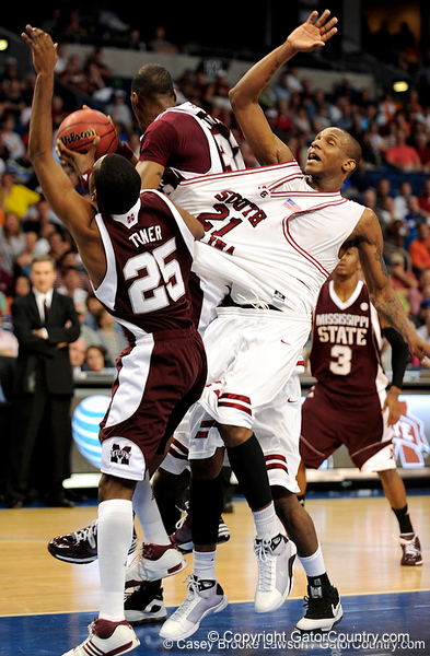 South Carolina forward Dominick Archie loses his shirt and footing as a MSU player steels the ball during the first half of the Mississippi State Bulldogs game against the South Carolina Gamecocks on Friday, March 13, 2009 in the St. Pete Times Forum. / Gator Country photo by Casey Brooke Lawson