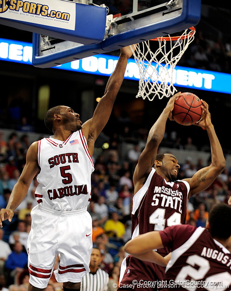 MIssissippi State forward Brian Johnson grabs for the ball during the first half of the Mississippi State Bulldogs game against the South Carolina Gamecocks on Friday, March 13, 2009 in the St. Pete Times Forum. / Gator Country photo by Casey Brooke Lawson