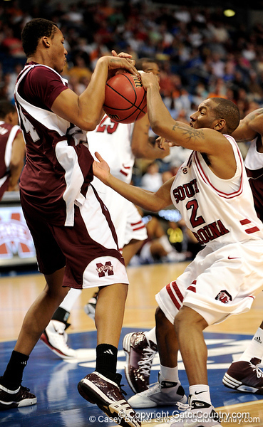 South Carolina guard Devan Downey attempts to grab the ball from a Mississippi State player during the first half of the Mississippi State Bulldogs game against the South Carolina Gamecocks on Friday, March 13, 2009 in the St. Pete Times Forum. / Gator Country photo by Casey Brooke Lawson