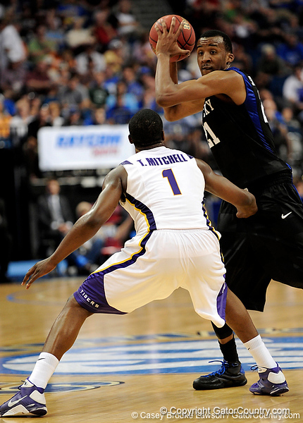 Kentucky player Perry Stevenson attempts to pass the ball around LSU forward Tasmin Mitchell during the LSU Tigers 67-58 victory over the Kentucky Wildcats on Friday, March 13, 2009 in the St. Pete Times Forum. / Gator Country photo by Casey Brooke Lawson