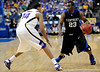 Kentucky player Jodie Meeks attempts to move the ball around LSU guard Garrett Temple during the LSU Tigers 67-58 victory over the Kentucky Wildcats on Friday, March 13, 2009 in the St. Pete Times Forum. / Gator Country photo by Casey Brooke Lawson