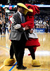 The Gamecock hugs a security guard during the first half of the Mississippi State Bulldogs game against the South Carolina Gamecocks on Friday, March 13, 2009 in the St. Pete Times Forum. / Gator Country photo by Casey Brooke Lawson