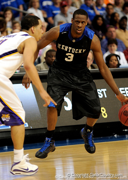Kentucky's Kevin Galloway attempts to move the ball around a LSU player during the LSU Tigers 67-58 victory over the Kentucky Wildcats on Friday, March 13, 2009 in the St. Pete Times Forum. / Gator Country photo by Casey Brooke Lawson