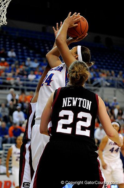 (Casey Brooke Lawson / Gator Country) UF junior forward Sharielle Smith attempts to score over a South Carolina player during the Gators 82 to 64 victory over South Carolina on Sunday, February 22, 2009.