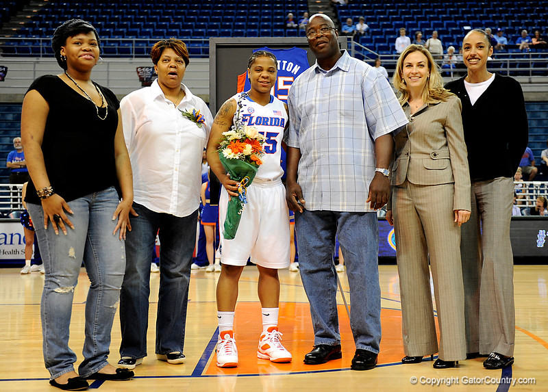 (Casey Brooke Lawson / Gator Country) UF senior Kim Critton stands with her parents, sister and coach after her last home victory. The Gators defeated South Carolina 82 to 64 on Sunday, February 22, 2009.