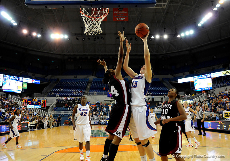 (Casey Brooke Lawson / Gator Country) UF freshman center Azania Stewart scores over Gamecocks forward C.J. Pace during the Gators 82 to 64 victory over South Carolina on Sunday, February 22, 2009.