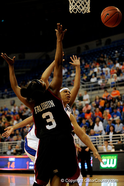 (Casey Brooke Lawson / Gator Country) UF junior Sharielle Smith loses the ball over a South Carolina player during the Gators 82 to 64 victory over South Carolina on Sunday, February 22, 2009.
