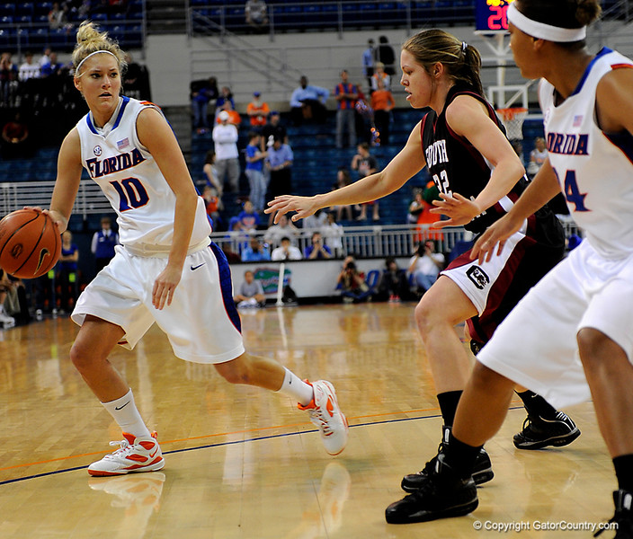 (Casey Brooke Lawson / Gator Country) UF junior guard Steffi Sorensen moves the ball around a South Carolina player during the Gators 82 to 64 victory over South Carolina on Sunday, February 22, 2009.