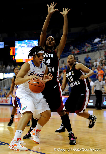 (Casey Brooke Lawson / Gator Country) UF senior forward Marshae Dotson attempts to move the ball past a South Carolina player during the Gators 82 to 64 victory over South Carolina on Sunday, February 22, 2009.