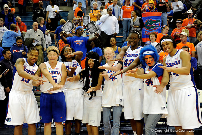 (Casey Brooke Lawson / Gator Country) UF seniors Kim Critton, Aneika Henry, Marshae Dotson and Sha Brooks stand with fans after their last home victory. The Gators defeated South Carolina 82 to 64 on Sunday, February 22, 2009.