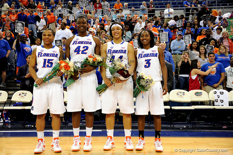 (Casey Brooke Lawson / Gator Country) UF seniors Kim Critton, Aneika Henry, Marshae Dotson and Sha Brooks stand together after their last home victory. The Gators defeated South Carolina 82 to 64 on Sunday, February 22, 2009.