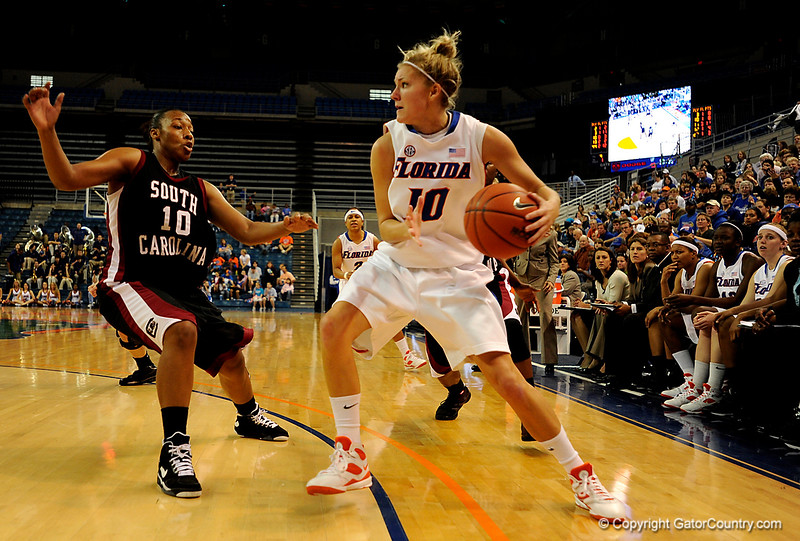 (Casey Brooke Lawson / Gator Country) UF guard Steffi Sorensen attempts to move the ball past two South Carolina players during the second half of the Gators 82 to 64 victory over South Carolina on Sunday, February 22, 2009.