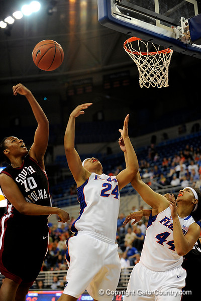 (Casey Brooke Lawson / Gator Country) UF junior Sharielle Smith attempts to score over a South Carolina player during the Gators 82 to 64 victory over South Carolina on Sunday, February 22, 2009.