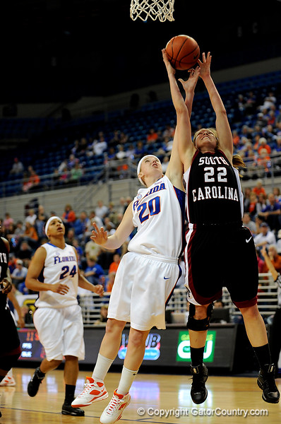 (Casey Brooke Lawson / Gator Country) UF junior guard Susan Yenser unsuccessfully blocks Gamecocks guard Courtney Newton from grabbing a rebound during the Gators 82 to 64 victory over South Carolina on Sunday, February 22, 2009.