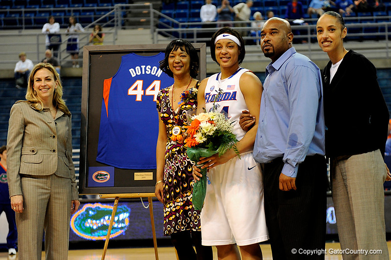 (Casey Brooke Lawson / Gator Country) UF senior Marshae Dotson stands with her parents and coach after her last home victory. The Gators defeated South Carolina 82 to 64 on Sunday, February 22, 2009.