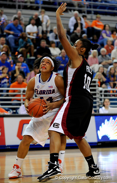(Casey Brooke Lawson / Gator Country) UF senior forward Marshae Dotson moves the ball past a South Carolina player to score during the Gators 82 to 64 victory over South Carolina on Sunday, February 22, 2009.