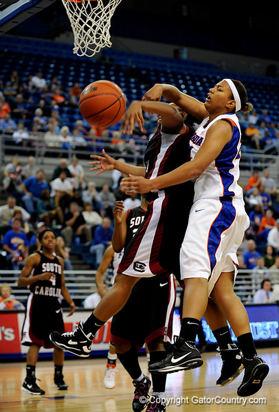 (Casey Brooke Lawson / Gator Country) UF junior forward Sharielle Smith loses the ball to a South Carolina player during the Gators 82 to 64 victory over South Carolina on Sunday, February 22, 2009.