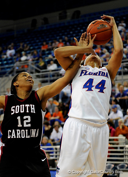 (Casey Brooke Lawson / Gator Country) UF senior forward Marshae Dotson scores over a South Carolina player during the Gators 82 to 64 victory over South Carolina on Sunday, February 22, 2009.