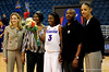 (Casey Brooke Lawson / Gator Country) UF senior Sha Brooks stands with her parents and coach after her last home victory. The Gators defeated South Carolina 82 to 64 on Sunday, February 22, 2009.