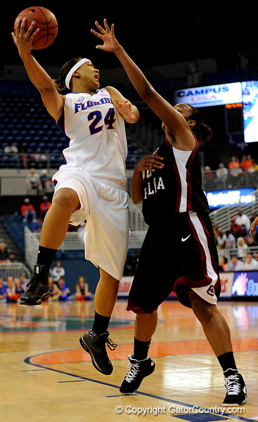 (Casey Brooke Lawson / Gator Country) UF junior Sharielle Smith attempts to move the ball past a South Carolina player during the Gators 82 to 64 victory over South Carolina on Sunday, February 22, 2009.