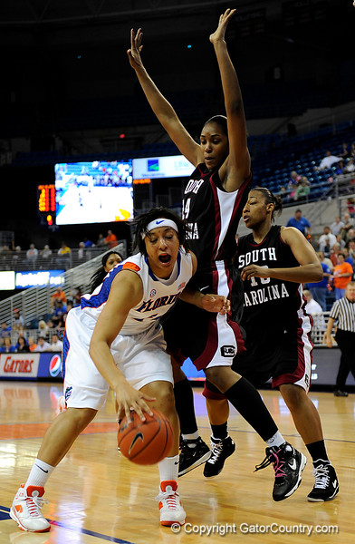 (Casey Brooke Lawson / Gator Country) UF senior Marshae Dotson attempts to move the ball around a South Carolina player during the Gators 82 to 64 victory over South Carolina on Sunday, February 22, 2009.