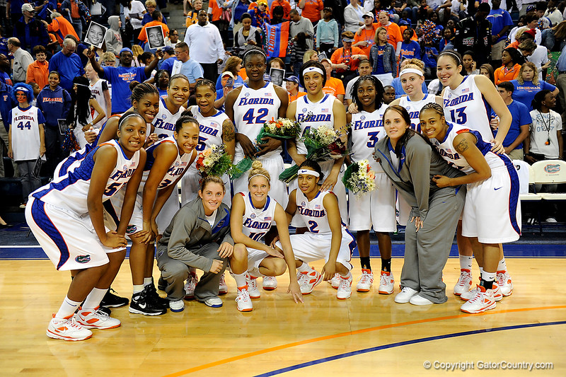 (Casey Brooke Lawson / Gator Country) UF seniors Kim Critton, Aneika Henry, Marshae Dotson and Sha Brooks stand with their team after their last home victory. The Gators defeated South Carolina 82 to 64 on Sunday, February 22, 2009.
